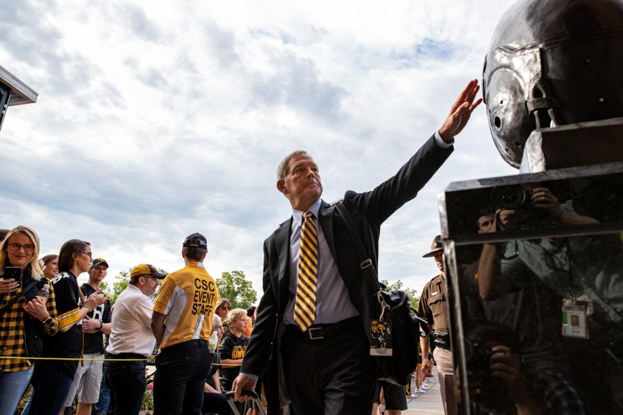 Iowa+Football+Head+Coach+Kirk+Ferentz+touches+a+statue+of+Nile+Kinnick+as+he+walks+into+Kinnick+Stadium+in+Iowa+City%2C+Iowa+on+September+7%2C+2019.+The+Hawkeyes+defeated+the+Scarlet+Knights+30-0.+