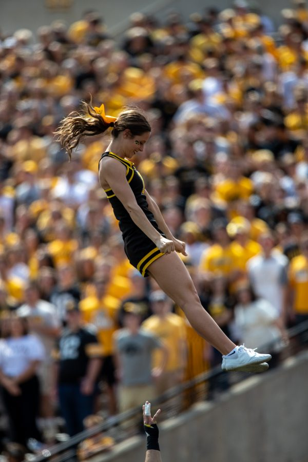 A cheeleader is thrown into the air during a football game between Iowa and Rutgers at Kinnick Stadium on Saturday, September 7, 2019. The Hawkeyes defeated the Scarlet Knights 30-0.