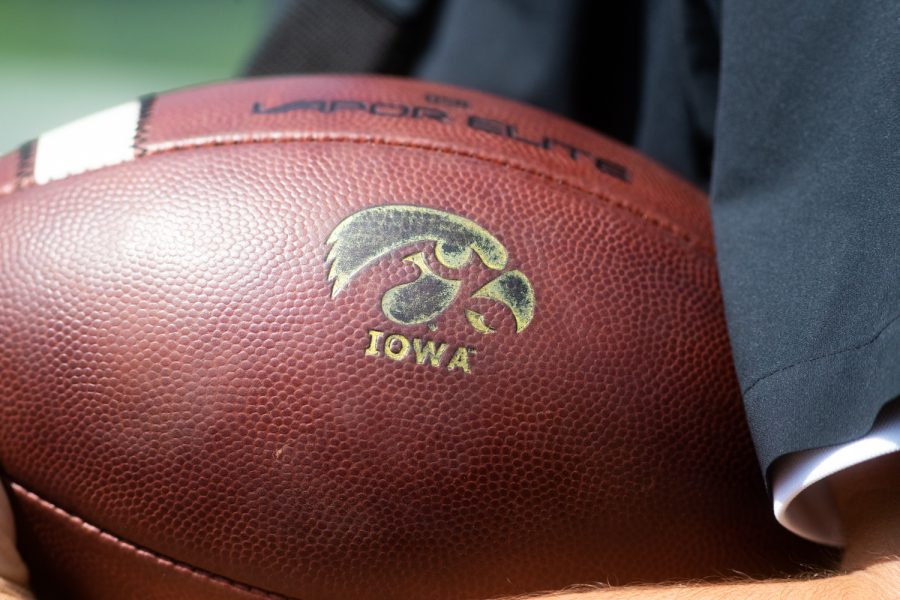 An event staff holds onto a game ball during a football game between Iowa and Rutgers at Kinnick Stadium on Saturday, September 7, 2019. The Hawkeyes defeated the Scarlet Knights 30-0.