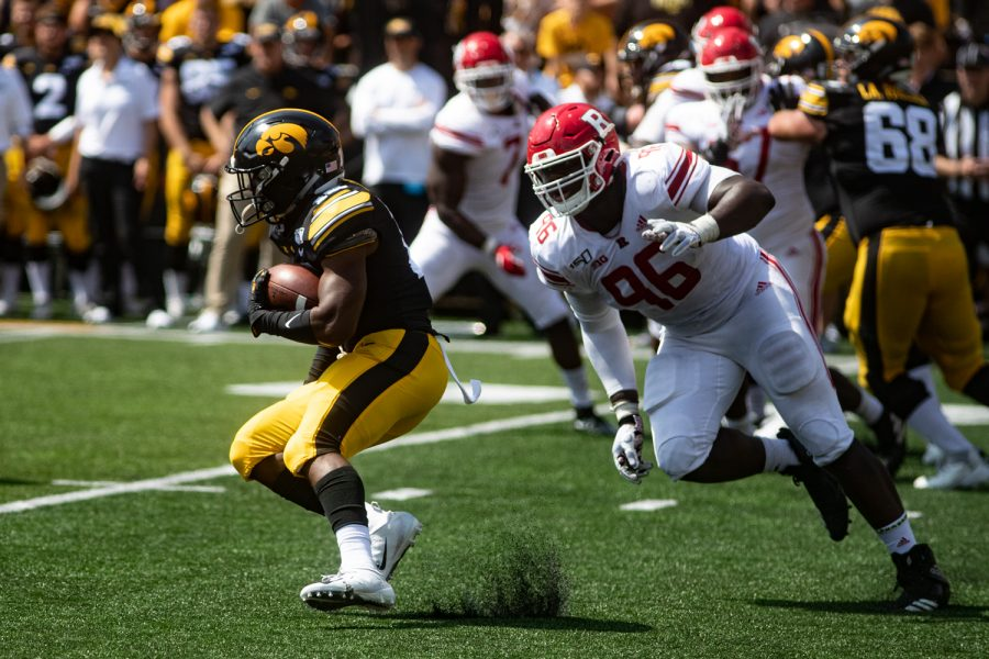 Iowa RB Mekhi Sargent jukes a Rutgers defender to miss a tackle during a football game between Iowa and Rutgers at Kinnick Stadium on Saturday, September 7, 2019. The Hawkeyes defeated the Scarlet Knights 30-0.