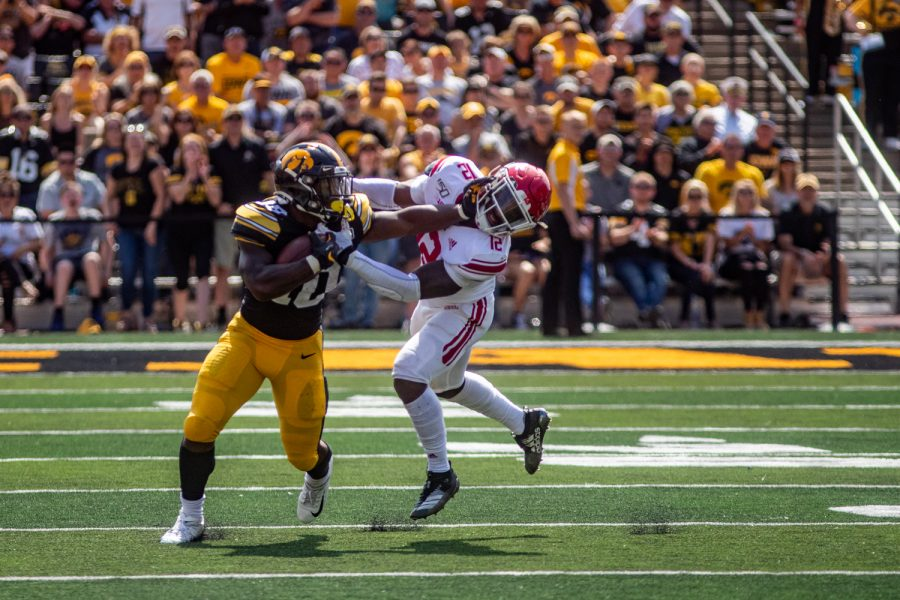 Iowa RB Mekhi Sargent stiff arms a Rurgers defender during a football game between Iowa and Rutgers at Kinnick Stadium on Saturday, September 7, 2019. The Hawkeyes defeated the Scarlet Knights 30-0.