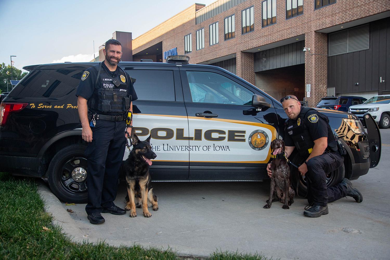 Officer Mohling (from left) K9 Brad, K9 Hogan and Officer Monter pose for a portrait on Tuesday, September 3, 2019.