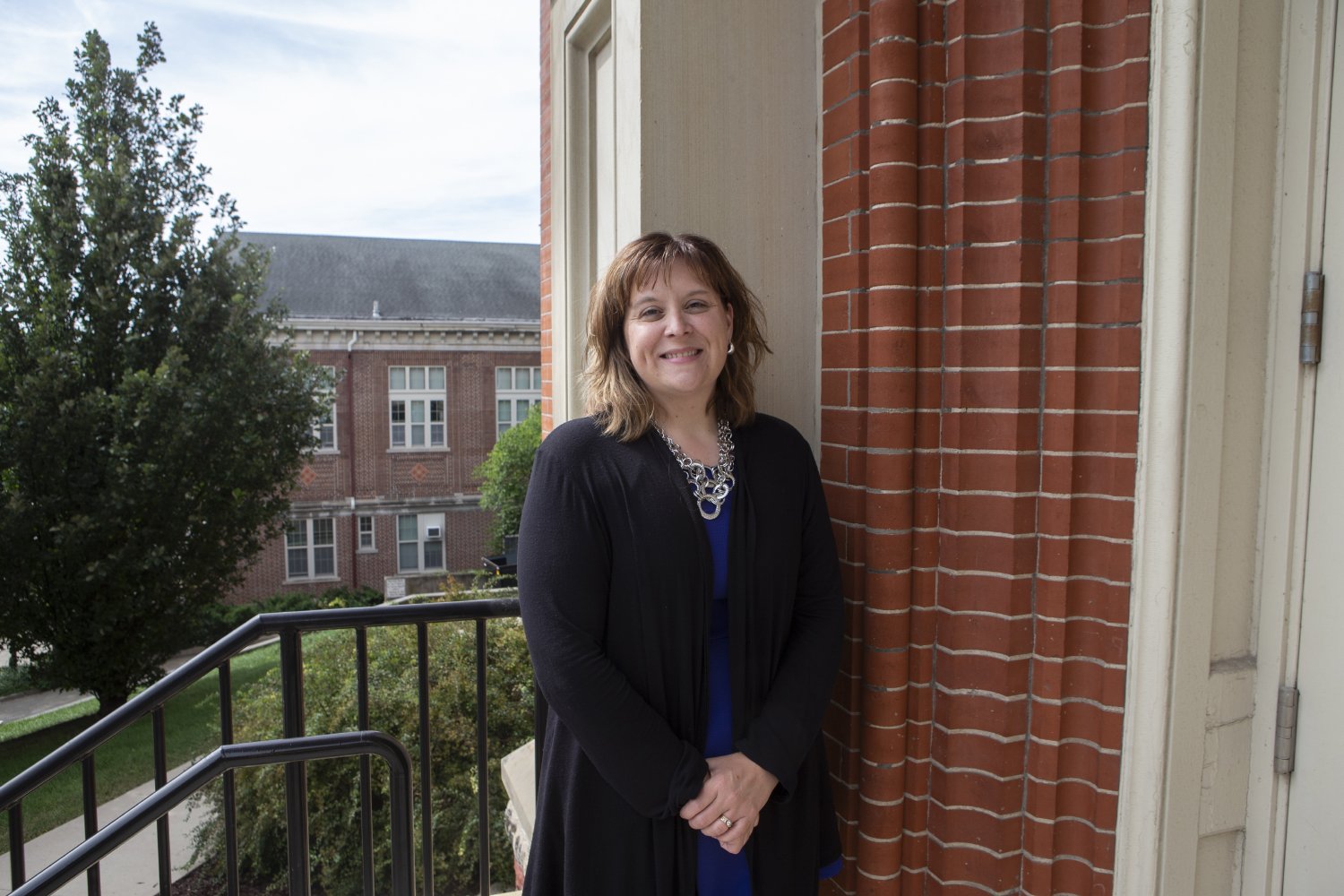 Academic Support and Retention assistant director Angie Lamb poses for a portrait outside of Calvin Hall on Sept. 19, 2019.
