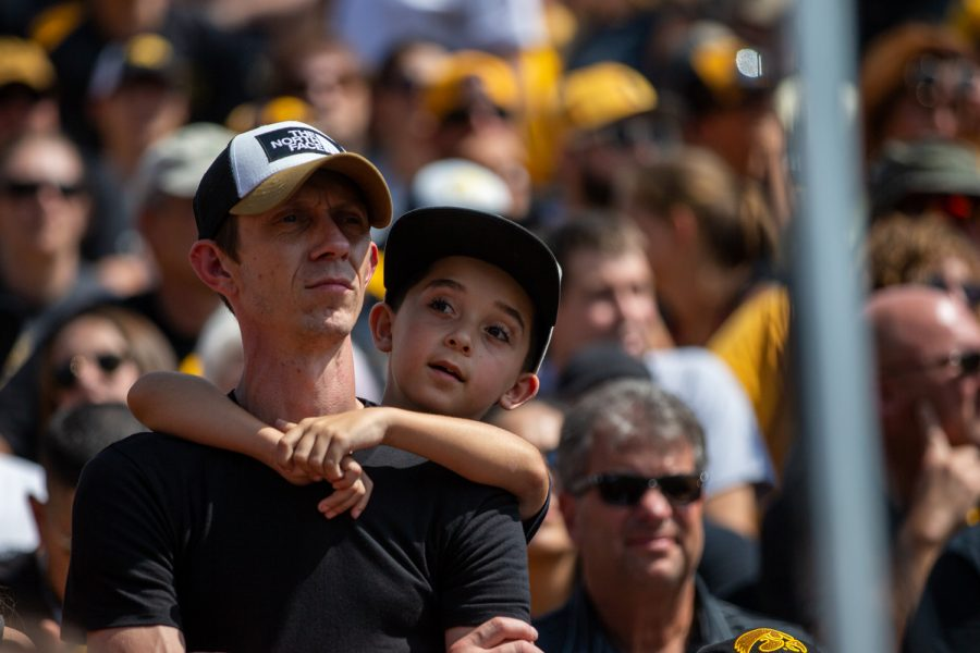A child holds on his father during a football game between Iowa and Rutgers at Kinnick Stadium on Saturday, September 7, 2019. The Hawkeyes defeated the Scarlet Knights 30-0.