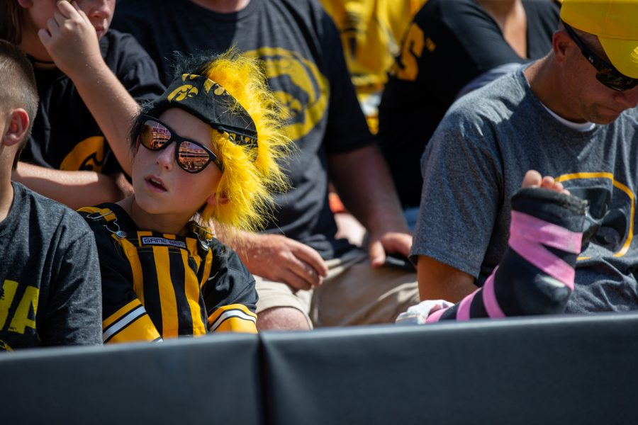 A child with a broken leg watches during a football game between Iowa and Rutgers at Kinnick Stadium on Saturday, September 7, 2019. The Hawkeyes defeated the Scarlet Knights 30-0.