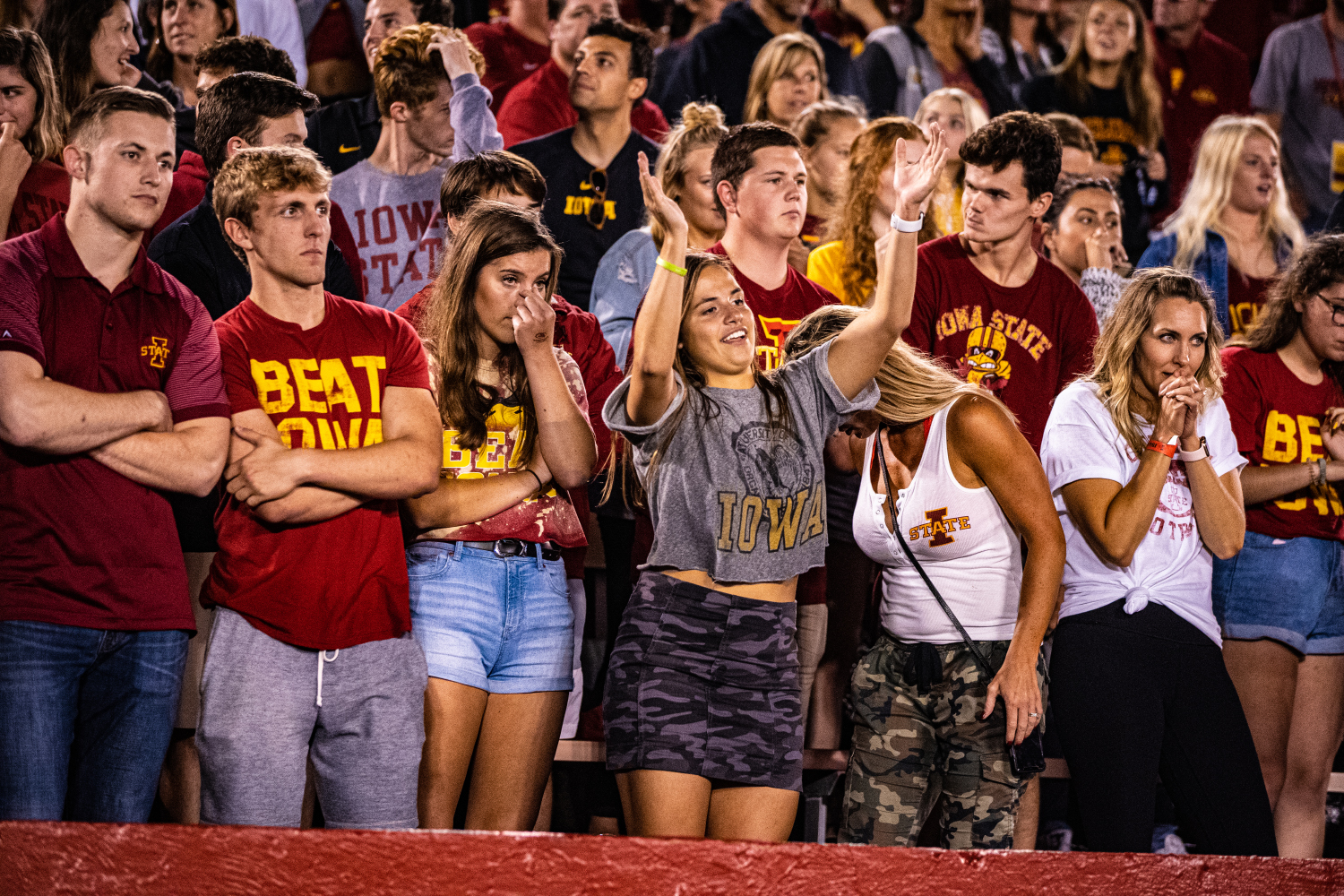 An Iowa fan celebrates a turnover on downs during a football game between Iowa and Iowa State at Jack Trice Stadium in Ames on Saturday, September 14, 2019. The Hawkeyes retained the Cy-Hawk Trophy for the fifth consecutive year, downing the Cyclones, 18-17.