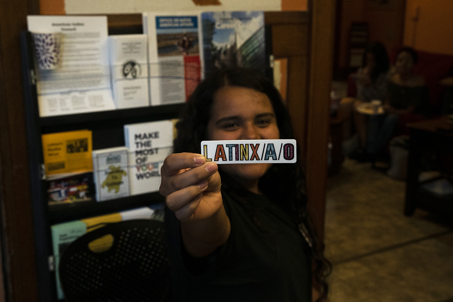 Latino Native American Cultural Center Student Lead Isabela Flores Lead presents a Latinx sticker in the Latino Native American Cultural Center on Sunday, September 19th, 2019. The Latino Native American Cultural Center is putting on multiple new events that span across different departments at the UI for graduate and undergraduate students.