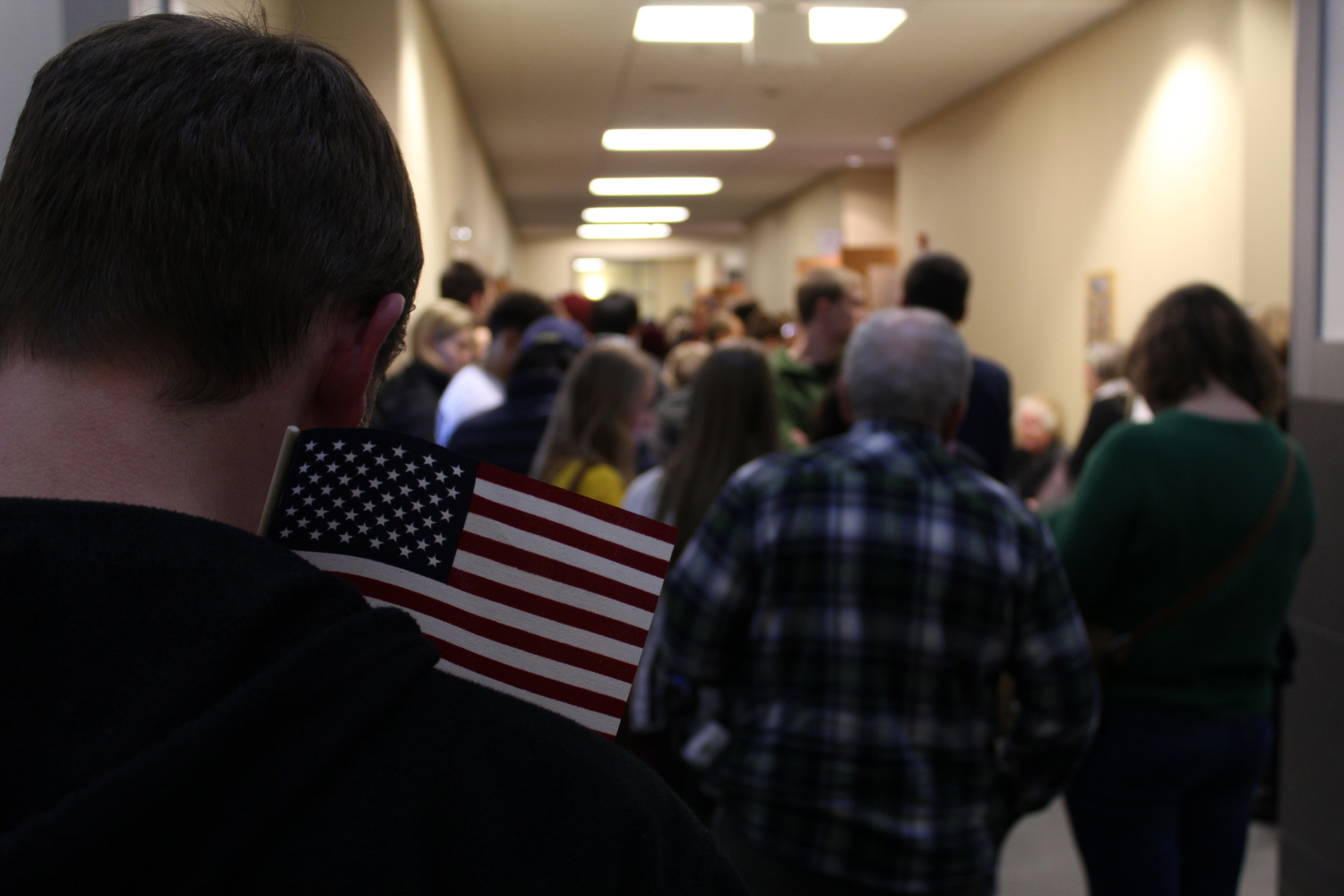 Voters wait patiently for the caucus to start on Monday Feb. 1, 2016. Many supporters come out to Iowa City Public Library.