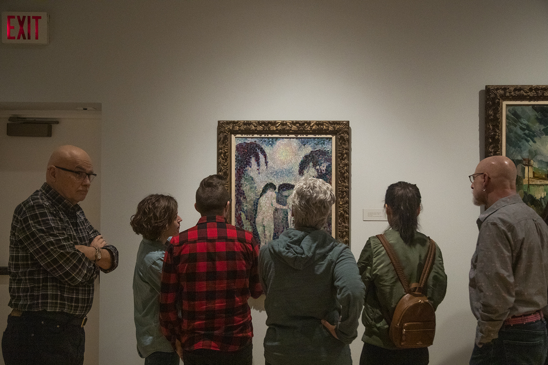 Attendees observe Jean Metzinger's