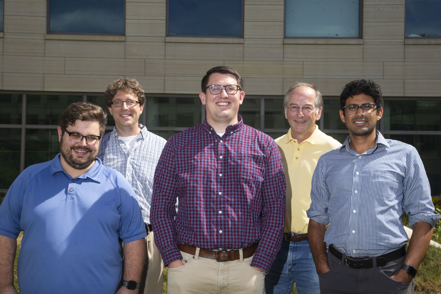 Researchers Philip Polgreen (top left), Jacob Simmering (bottom left), Jordan Schultz (center), Michael Welsh (top right) and Kumar Narayanan (bottom right) pose for a portrait outside of the Pappajohn Biomedical Discovery Building on Monday Sept. 16, 2019. (Katie Goodale/The Daily Iowan)