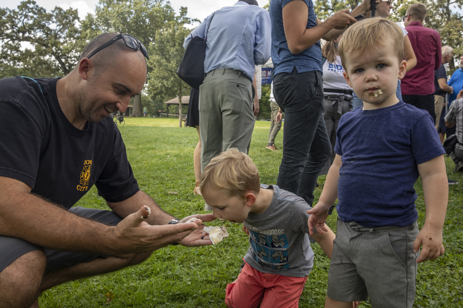 Sam+Brown+and+sons+Leo+and+Logan+eat+the+ice+cream+handed+out+by+Former+Vice+President+Joe+Biden+during+the+Iowa+City+Federation+of+Labor+Labor+Day+Picnic+in+City+Park+on+September+2%2C+2019.+Among+the+candidates+to+attend+the+event+were+Sen.+Michael+Bennet+and+Former+Vice+President+Joe+Biden.+%28Ryan+Adams%2F+The+Daily+Iowan%29