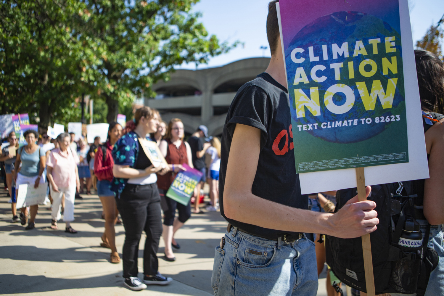 Climate strikers march from City Hall to the Pentacrest to raise awareness about the threat of climate change. The march was one of hundreds taking place around the world on Friday, Sept. 20. (Reba Zatz/The Daily Iowan)