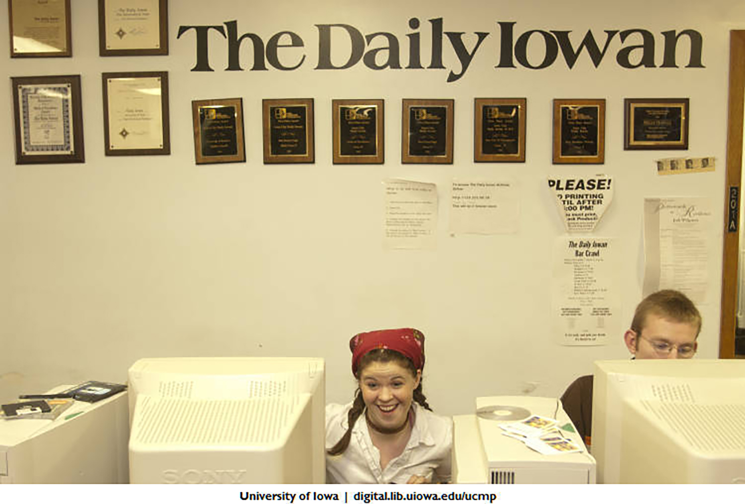 Daily Iowan staffers are seen working in their office in the Communications Building.