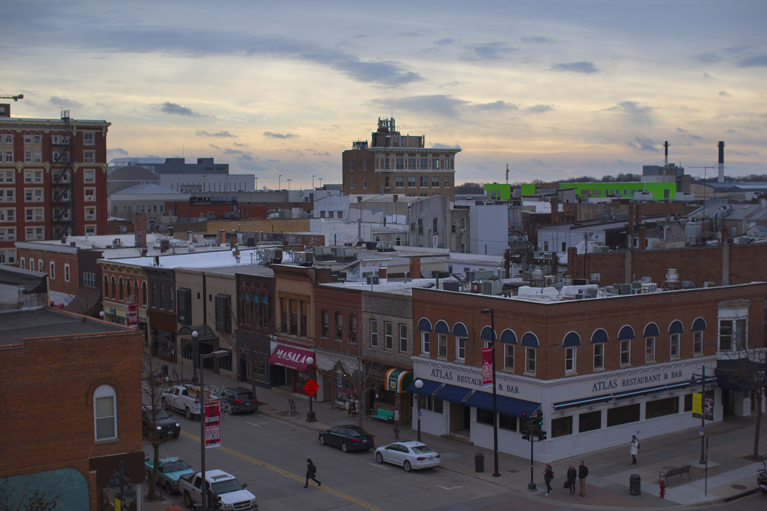 People walk around downtown on Tuesday, Jan 31, 2017. Iowa City was named City of Literature by Unesco City of Literature.