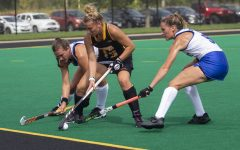 Iowa forward Leah Zellner tries to shield the ball from two Duke players during a field hockey game at Grant Field on Sunday, September 15, 2019. The Hawkeyes were defeated by the Blue Devils, 2-1 after two overtime periods. (Hannah Kinson/The Daily Iowan)