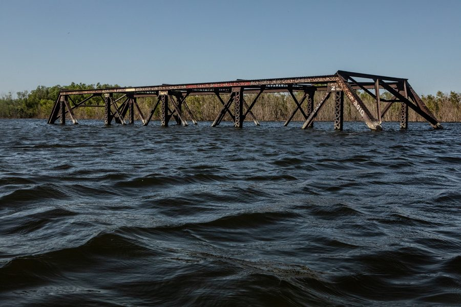 An iron bridge on Greencastle Road south of Swisher, Iowa sits in the waters of Coralville Reservoir on June 10, 2019. The reservoir water level peaked at almost 705 feet on June 5, 2019.
