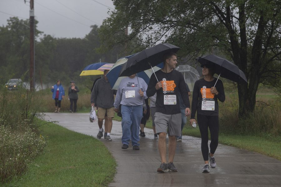 Participants+fend+off+the+rain+during+the+2019+Iowa+Miles+for+Myeloma+Run%2FWalk+at+Terry+Trueblood+Recreation+Area+on+Sunday%2C+September+22%2C+2019.+