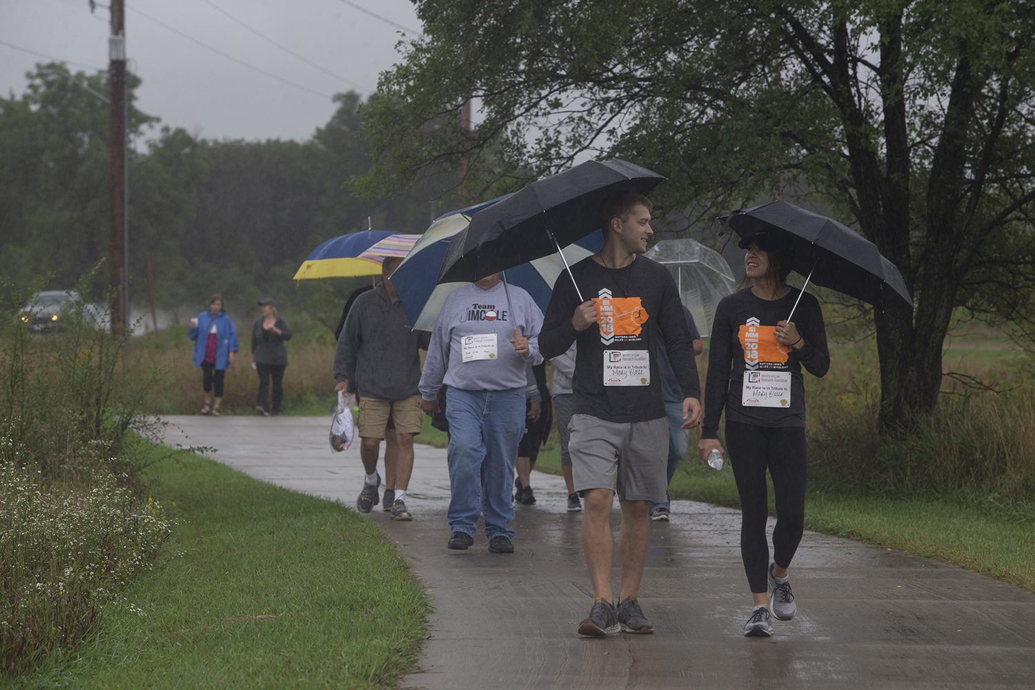 Participants fend off the rain during the 2019 Iowa Miles for Myeloma Run/Walk at Terry Trueblood Recreation Area on Sunday, September 22, 2019.