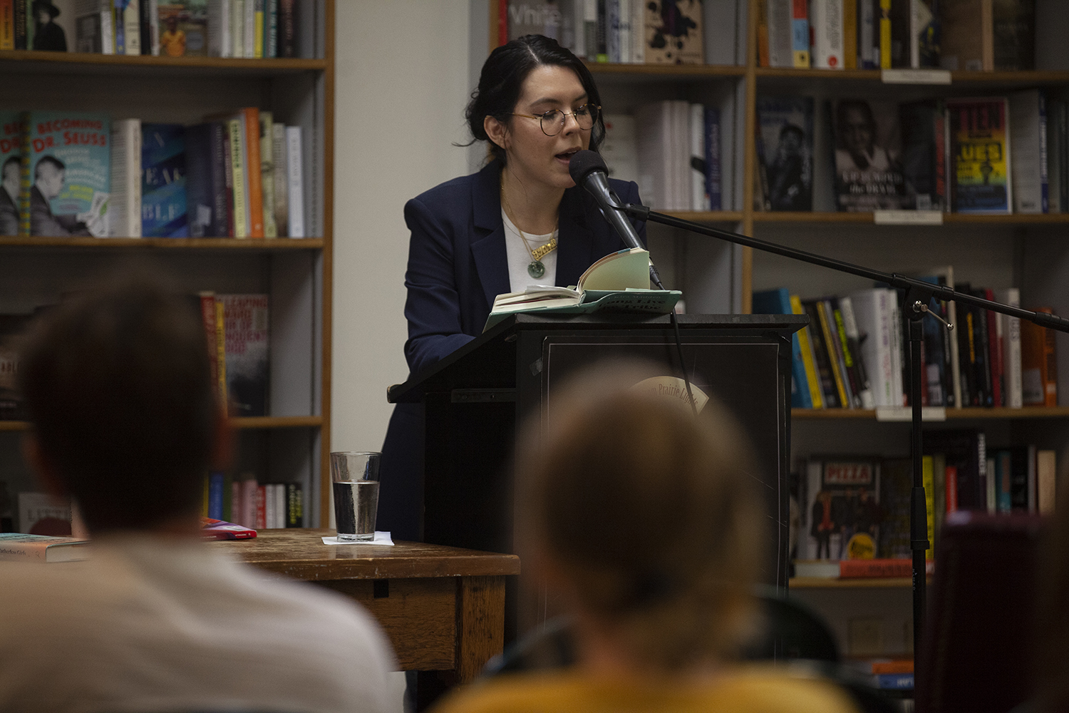 "Author T Kira Madden reads aloud from her memoir, ""Long Live the Tribe of Fatherless Girls"" at a reading at Prairie Lights bookstore on Thursday, September 12, 2019. The memoir highlights Madden's experience growing up biracial and queer, and Madden spoke on the topic with openness and humor. (Jenna Galigan/The Daily Iowan)."