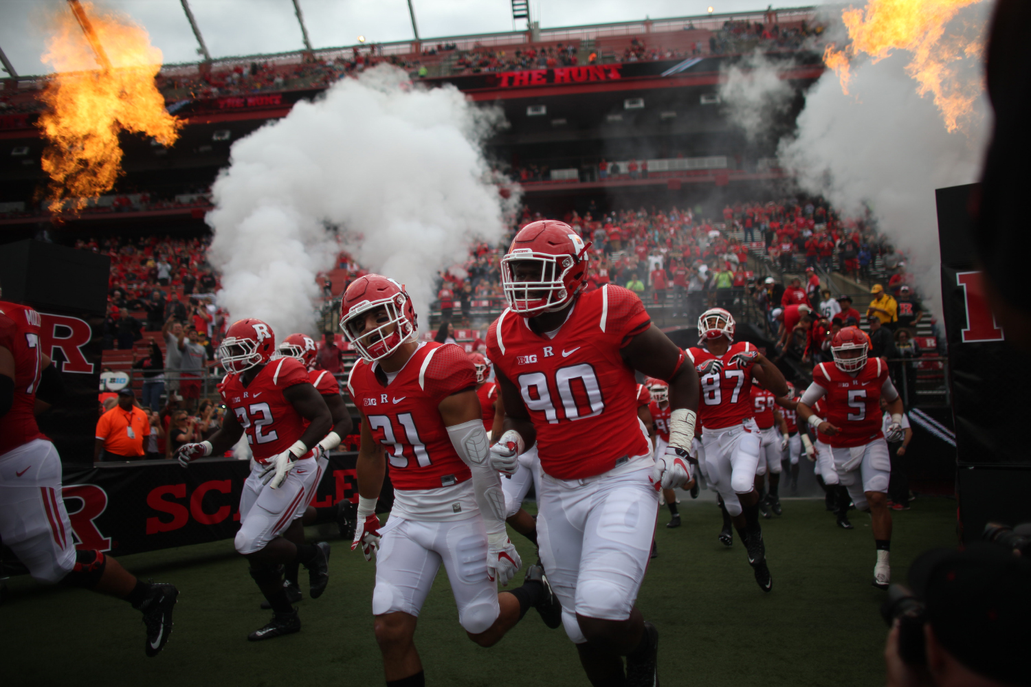 The Rutgers team runs onto the field during the Iowa-Rutgers game at High Point Solution Stadium at Piscataway on Saturday, Sept. 24, 2016. The Hawkeyes defeated the Knights, 14-7. (The Daily Iowan/Margaret Kispert)