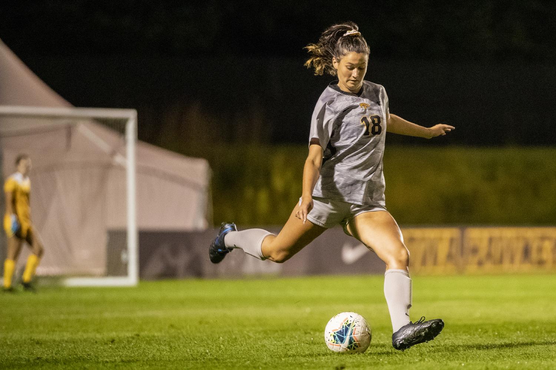 University of Iowa Defender Diane Senkowski kicks ball to fellow Midfielders. (Daily Iowan/Mason Childs)