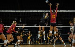 Iowa setter Courtney Buzzerio goes for a kill during a volleyball match between Iowa and Iowa State at Carver-Hawkeye Arena on Saturday, September 21, 2019. The Hawkeyes fell to the visiting Cyclones, 3-2. (Shivansh Ahuja/The Daily Iowan)