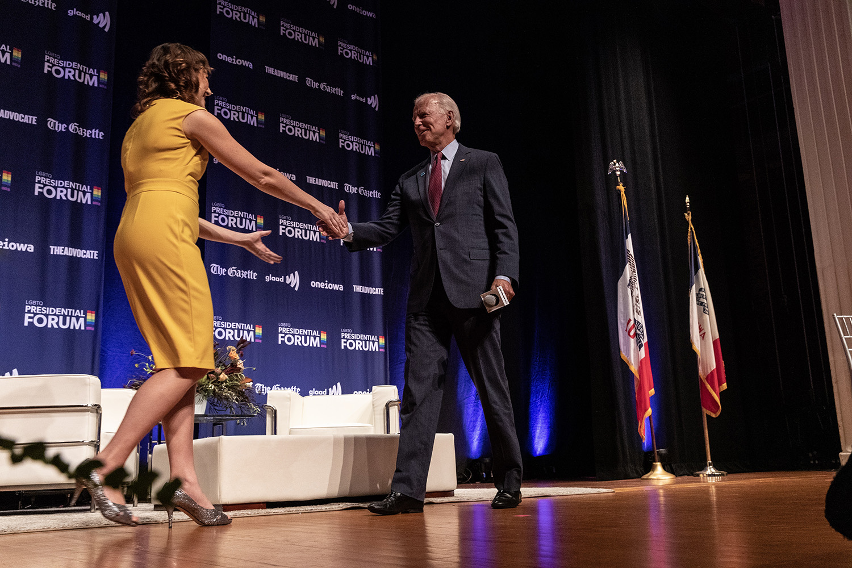 Former Vice President Joe Biden shakes the hand of moderator Lyz Lenz at the LGBTQ forum Friday Sept. 20