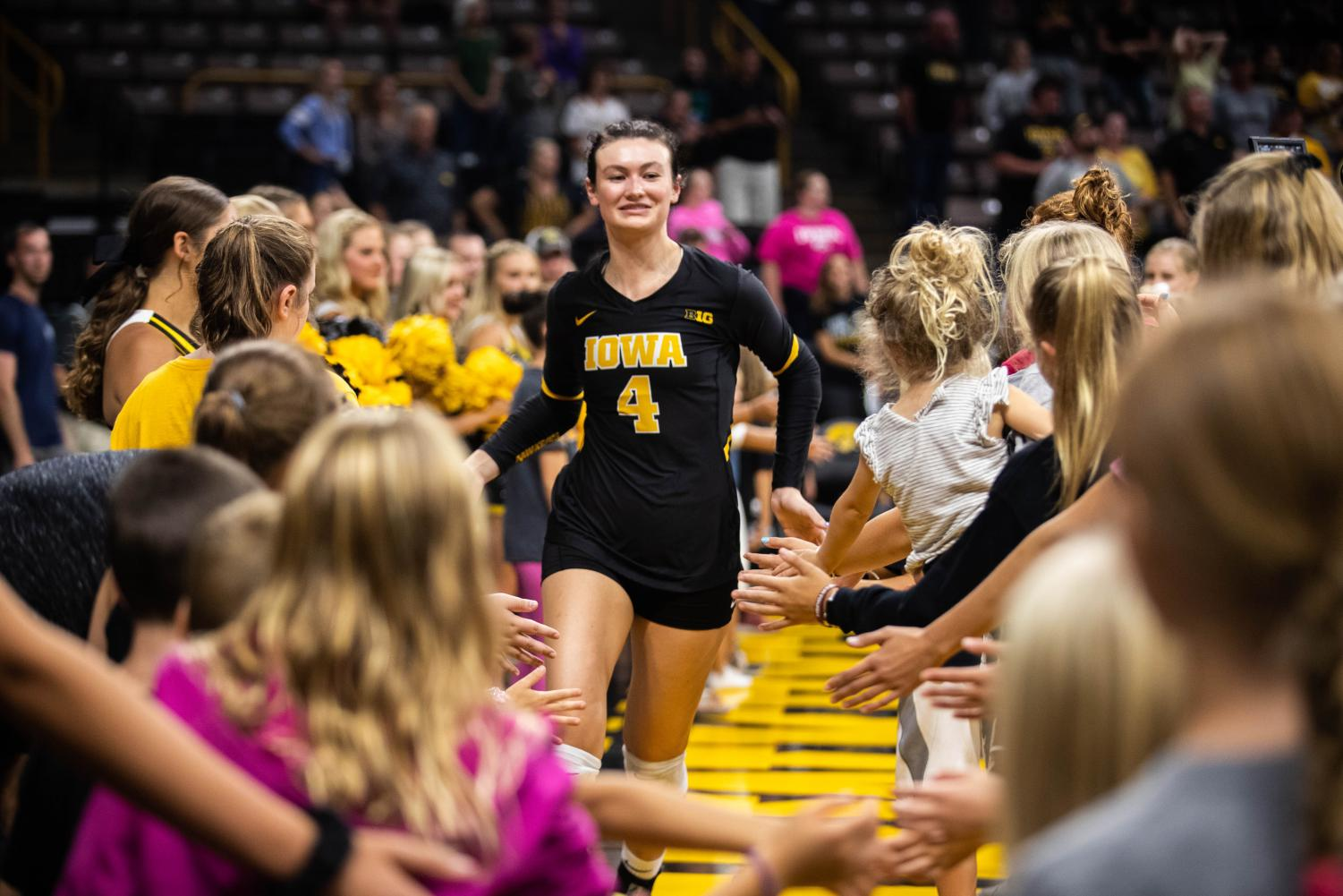 Iowa+defensive+specialist+Halle+Johnston+high+fives+kids+before+a+volleyball+match+between+Iowa+and+Washington+at+Carver+Hawkeye+Arena+on+Saturday%2C+September+7%2C+2019.+The+Hawkeyes+were+defeated+by+the+Huskies%2C+3-1.