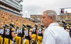 Iowa head coach Kirk Ferentz watches his players swarm the field before a football game between Iowa and Middle Tennessee State University on Saturday, September 28, 2019. The Hawkeyes defeated the Blue Raiders 48-3.