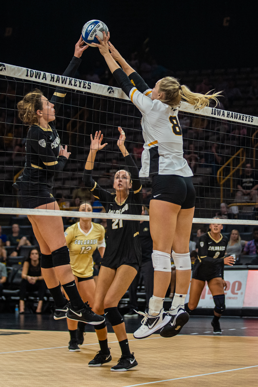 Iowa+outside+hitter+Kyndra+Hansen+%288%29+blocks+the+ball+during+a+volleyball+match+between+Iowa+and+Colorado+in+Carver-Hawkeye+Arena+on+Friday%2C+September+6%2C+2019.+The+Hawkeyes+dropped+their+season+opener+to+the+Buffaloes%2C+3-0.