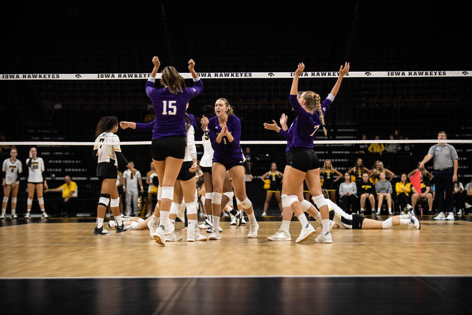 Washington+players+celebrate+a+point+during+a+volleyball+match+between+Iowa+and+Washington+at+Carver+Hawkeye+Arena+on+Saturday%2C+September+7%2C+2019.+The+Hawkeyes+were+defeated+by+the+Huskies%2C+3-1.
