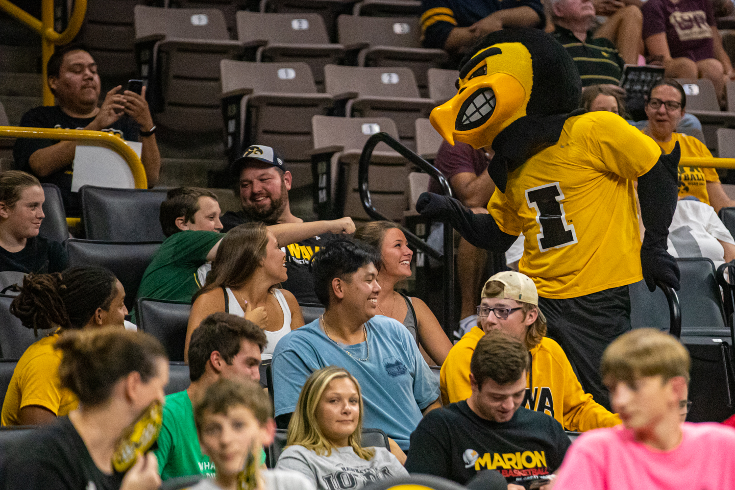 Herky+fist-bumps+a+fan+during+a+volleyball+match+between+Iowa+and+Colorado+in+Carver-Hawkeye+Arena+on+Friday%2C+September+6%2C+2019.+The+Hawkeyes+dropped+their+season+opener+to+the+Buffaloes%2C+3-0.