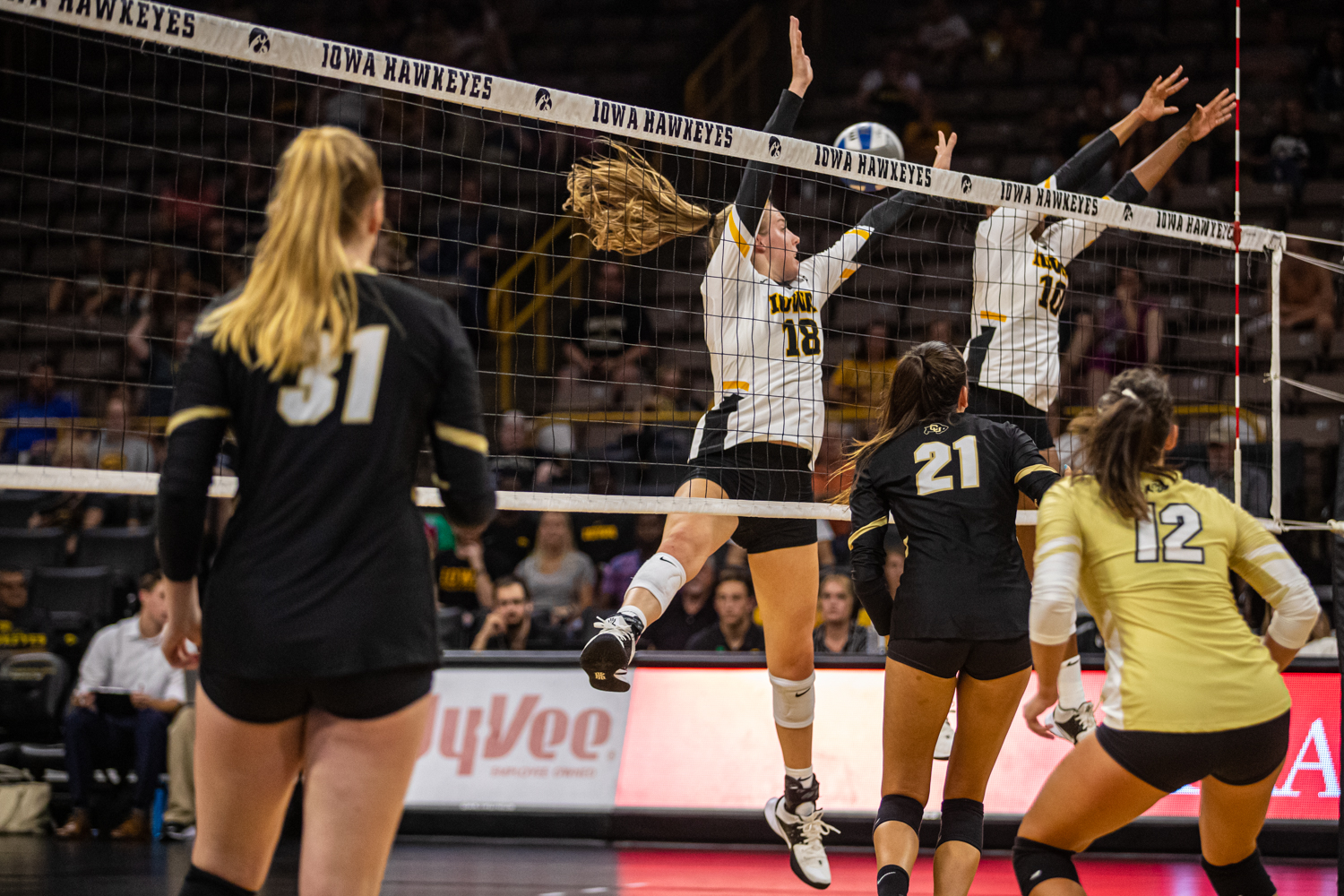 Iowa%27s+Hannah+Clayton+%2818%29+and+Griere+Hughs+go+for+a+block+during+a+volleyball+match+between+Iowa+and+Colorado+in+Carver-Hawkeye+Arena+on+Friday%2C+September+6%2C+2019.+The+Hawkeyes+dropped+their+season+opener+to+the+Buffaloes%2C+3-0.
