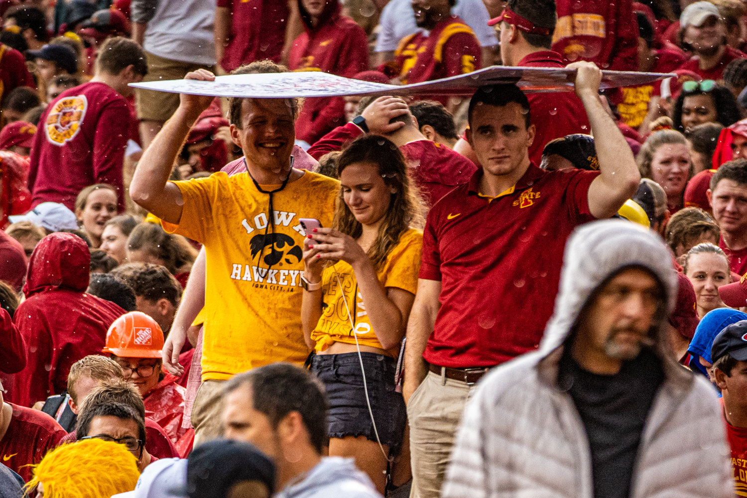 Spectators sit in the rain during a football game between Iowa and Iowa State at Jack Trice Stadium in Ames on Saturday, September 14, 2019. The Hawkeyes retained the Cy-Hawk Trophy for the fifth consecutive year, downing the Cyclones, 18-17.