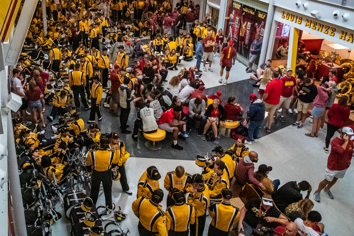 Marching band members escape the rain during a football game between Iowa and Iowa State at Jack Trice Stadium in Ames on Sept. 14, 2019.