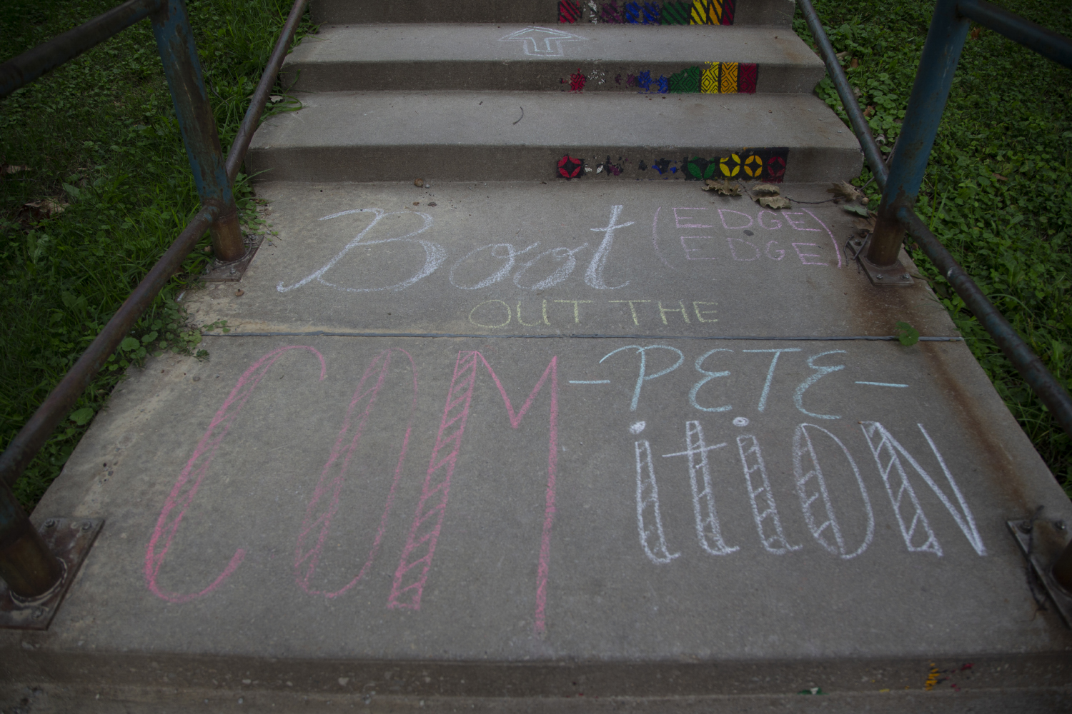 Chalk+is+seen+on+a+sidewalk+advertising+the+lawn+event+celebrating+the+opening+of+a+new+campaign+office+for+2020+Democratic+candidate+Pete+Buttigieg+in+downtown+Iowa+City+on+September+2%2C+2019.