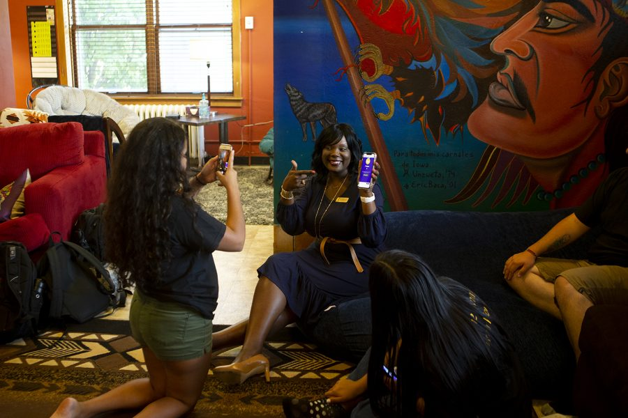 UI Vice President for Student Life Melissa Shivers poses with her phone after winning a game of Kahoot with students at the Latino-Native American Cultural Center during the UI Cultural Centers open house on Tuesday, Sept. 3, 2019. The game of Kahoot was based on the history of LNACC.