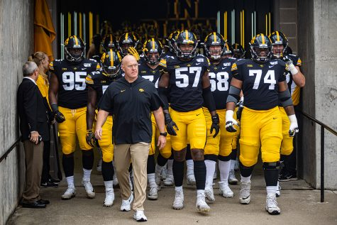 Iowa players walk out of the tunnel before a football game between Iowa and Middle Tennessee State at Kinnick Stadium on Saturday, September 28, 2019. The Hawkeyes defeated the Blue Raiders, 48-3. (Shivansh Ahuja/The Daily Iowan)
