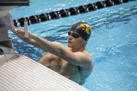 A Hawkeye takes his mark for a backstroke event at the swim meet on Friday, October 4. The Iowa men won over Michigan State, 180 to 112. The Iowa women won over Michigan State 183 to 113. The women also won over Northern Iowa. 183 to 113. Michigan State won over Northern Iowa 180 to 120.