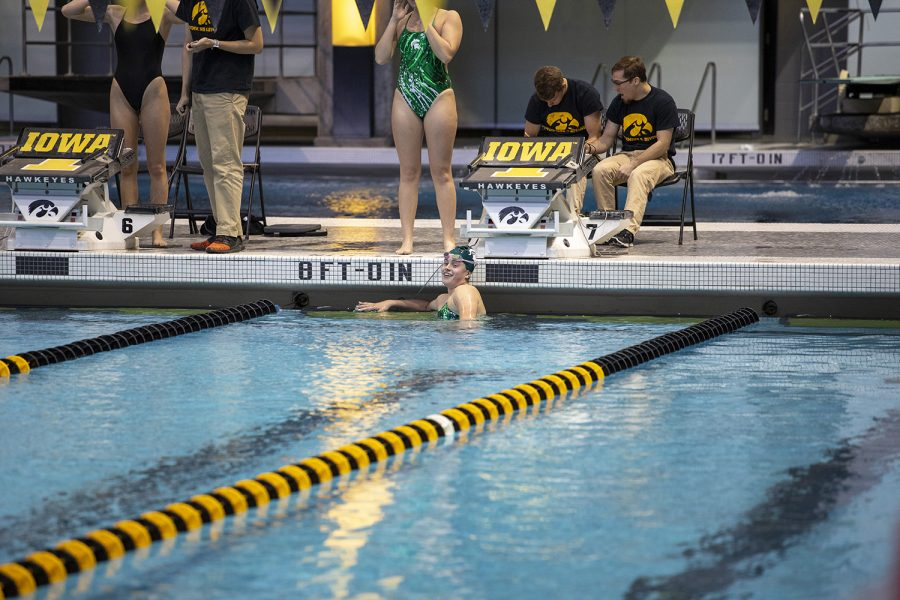 A Michigan State swimmer celebrates a 1st place win after her event at the swim meet on Friday, October 4. The Iowa men won over Michigan State, 180 to 112. The Iowa women won over Michigan State 183 to 113. The women also won over Northern Iowa. 183 to 113. Michigan State won over Northern Iowa 180 to 120.