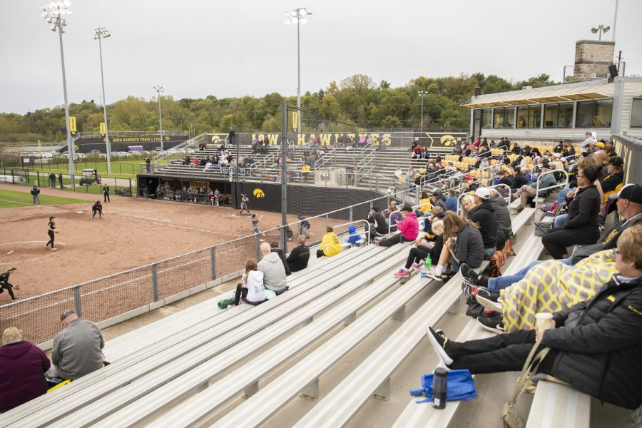 Spectators+watch+a+pitch+and+swing+at+the+Iowa+softball+game+against+Indian+Hills+at+Pearl+Field+on+Sunday%2C+October+6th%2C+2019.+The+Hawkeyes+defeated+the+Warriors+21-2.+