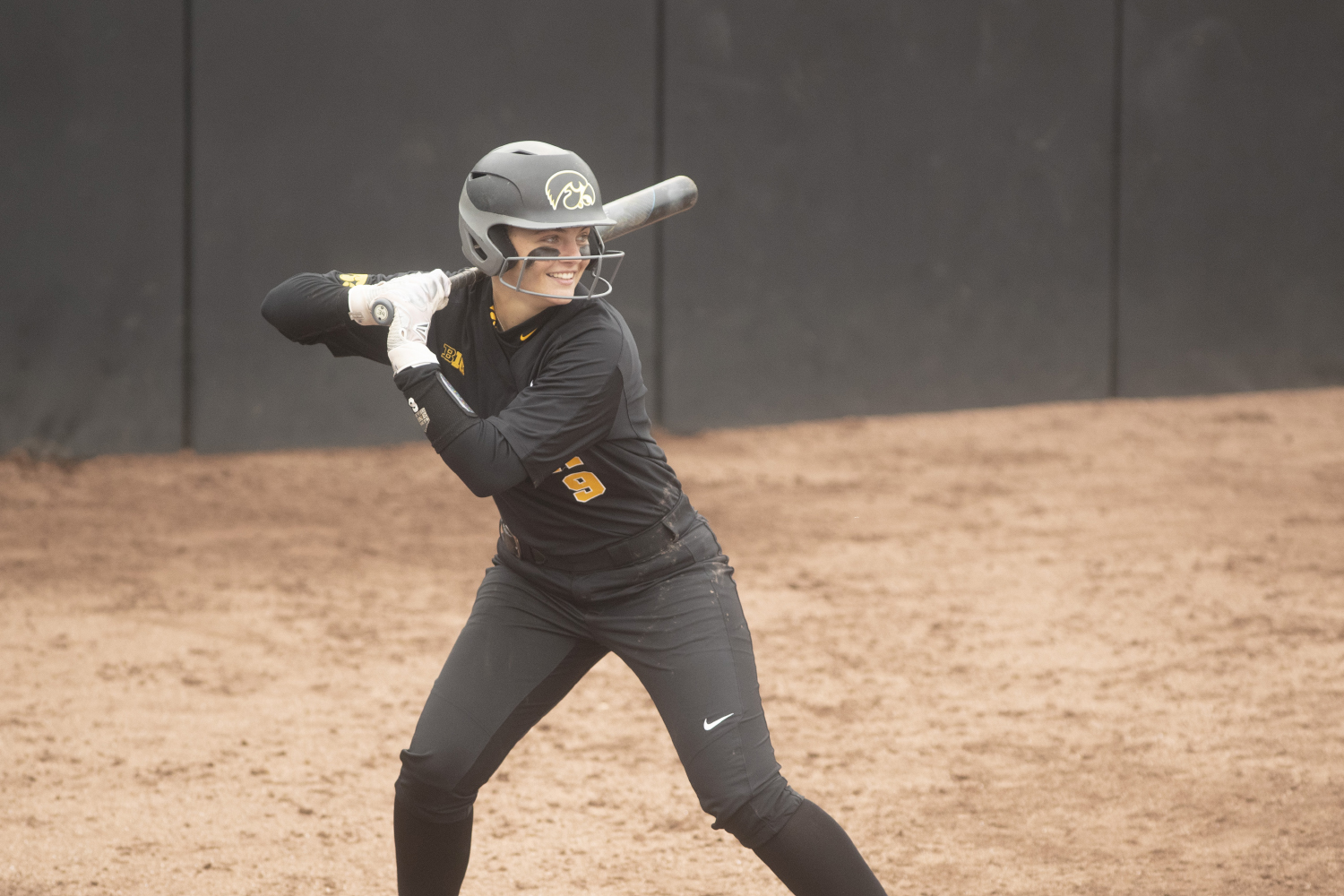 Iowa pitcher Lauren Shaw winds up for a swing at the Iowa softball game against Indian Hills at Pearl Field on Sunday, October 6th, 2019. The Hawkeyes defeated the Warriors 21-2.