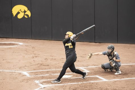 Iowa infielder Kalena Burns makes a hit at the Iowa softball game against Indian Hills at Pearl Field on Sunday, Oct. 6, 2019.