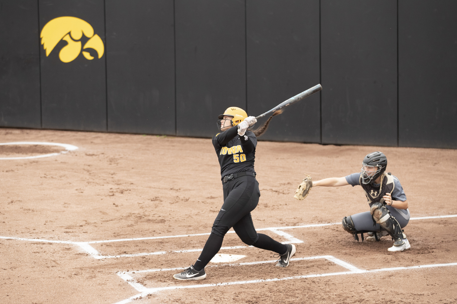 Iowa infielder Kalena Burns makes a hit at the Iowa softball game against Indian Hills at Pearl Field on Sunday, October 6th, 2019. The Hawkeyes defeated the Warriors 21-2.