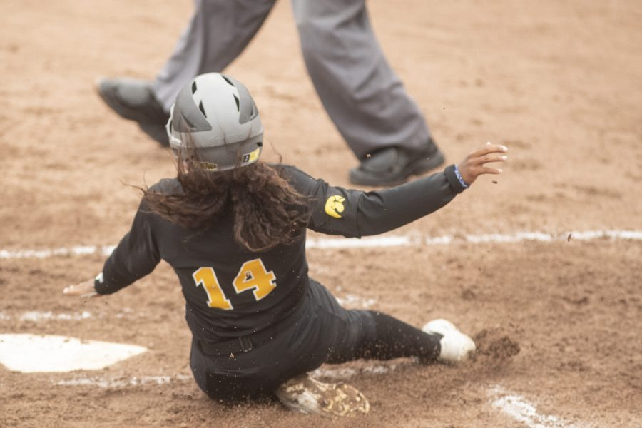 Iowa infielder Nia Carter slides to home plate at the Iowa softball game against Indian Hills at Pearl Field on Sunday, October 6th, 2019. The Hawkeyes defeated the Warriors 21-2.