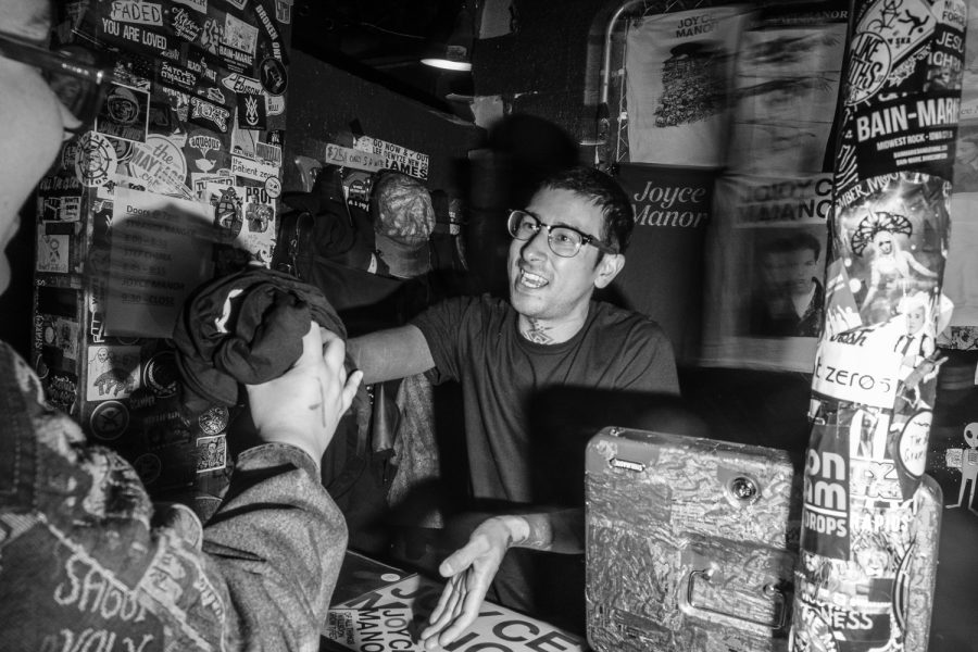 Attendees purchase merchandise after the Joyce Manor concert at Gabe's in Iowa City on Wednesday, October 9, 2019. Joyce Manor is a punk band from Torrance, California.
