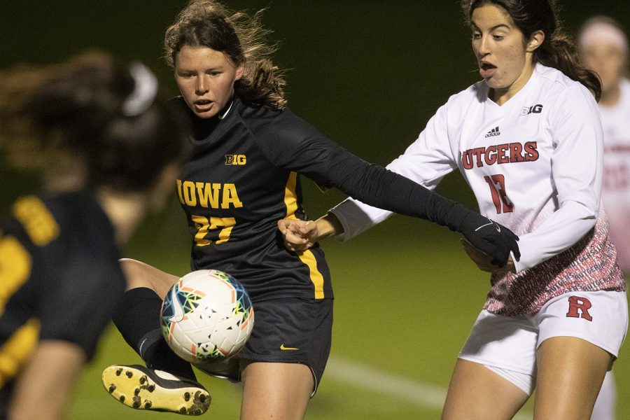 Iowa+forward+Samantha+Tawharu+fends+off+Rutgers+midfielder+Gabby+Provenzano+during+the+Iowa+v+Rutgers+soccer+game+at+the+Iowa+Soccer+Complex+on+Friday%2C+October+11%2C+2019.+The+Hawkeyes+fell+to+the+Scarlet+Knights+0-1.
