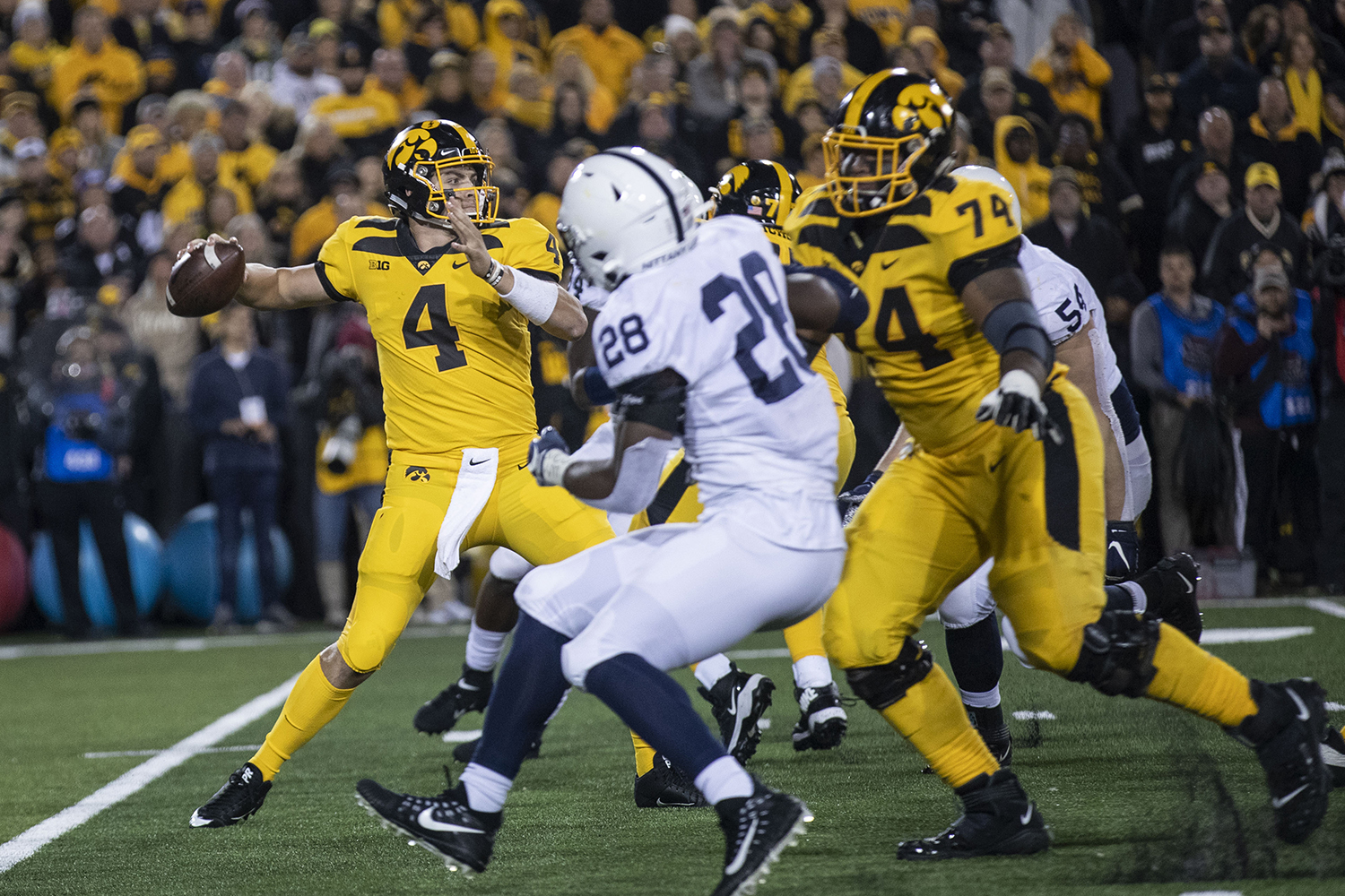 Iowa QB Nate Stanley throws a pass during the Iowa football vs. Penn State game in Kinnick Stadium on Saturday, Oct. 12, 2019. The Nittany Lions defeated the Hawkeyes 17-12.