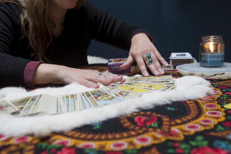 Dawn Frary shows a deck of tarot cards on Saturday, Oct. 12, 2019. Frary performed a demonstration tarot reading at Over the Moon Studio, a shared workspace downtown. (Emily Wangen/The Daily Iowan)