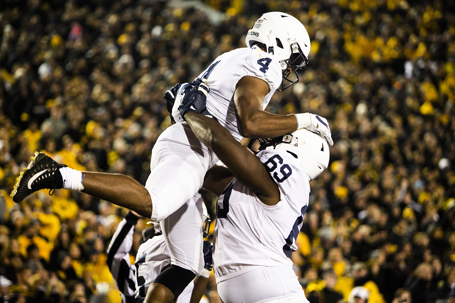 Penn State running back Journey Brown (left) and offensive lineman C.J. Thorpe celebrate a touchdown during the Iowa football game against Penn State in Iowa City on Saturday, Oct. 12, 2019. The Nittany Lions defeated the Hawkeyes 17-12.